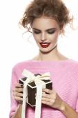 Beautiful woman with evening make-up takes box with present — Stock Photo