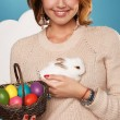Beautiful woman holding white little Easter bunny basked eggs — Stock Photo #60952539