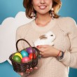 Beautiful woman holding white little Easter bunny basked eggs — Stock Photo #60952561