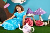 Beautiful little girl long hear blue dress with rabbit — Stock Photo