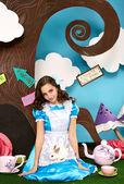Beautiful little girl long hear blue dress with rabbit — Stock Photo