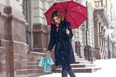 Beautiful woman snow street buy presents Christmas New Yea — Stock Photo