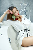 Sexy woman in bathroom in silk robe rose Valentine's day — Stock Photo