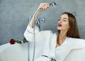 Sexy woman in bathroom in silk robe rose Valentine's day  — Foto Stock