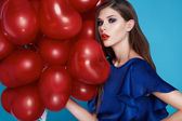 Beautiful sexy brunette woman makeup Valentine's day balloons — Stock fotografie