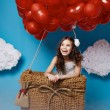 Small cute girl flying on red heart balloons Valentines day — Stock Photo #64095907