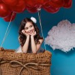 Small cute girl flying on red heart balloons Valentines day — Stock Photo #64095937