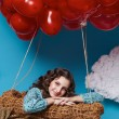 Small cute girl flying on red heart balloons Valentines day — Stock Photo #64096037