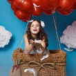 Small cute girl flying on red heart balloons Valentines day — Stock Photo #64096039