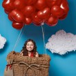 Small cute girl flying on red heart balloons Valentines day — Stock Photo #64096071