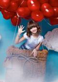 Small cute girl flying on red heart balloons Valentines day — Φωτογραφία Αρχείου