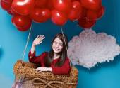 Small cute girl flying on red heart balloons Valentines day — Foto Stock