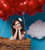 Small cute girl flying on red heart balloons Valentines day — Stock Photo