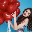 Beauty sexy woman with red heart baloon Valentines day birthday — Stock Photo #64535853