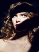 Beautiful sexy woman makeup red lips curly hair — Zdjęcie stockowe