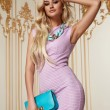 Beautiful sexy woman blond hair pink evening dress acsessory — Stock Photo #65623409