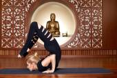 Beautiful woman yoga pilates gymnastics meditation Buddha — Stock Photo