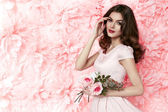 Beautiful sexy woman in dress many flowers makeup summer spring — Stock Photo