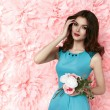 Beautiful sexy woman in dress many flowers makeup summer spring — Stock Photo #67825935