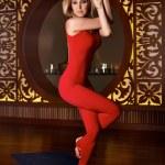 Beautiful sexy blond woman doing yoga pilates fitness — Stock Photo #67984193