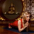 Beautiful sexy blond woman doing yoga pilates fitness — Stock Photo #67984283
