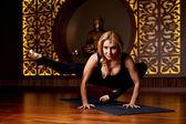 Beautiful sexy blond woman doing yoga pilates fitness — Stock Photo