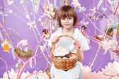 Little girl with basket eggs Easter bunny smile — Foto de Stock
