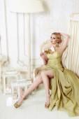 Beautiful sexy blond woman  in evening dress  — Stock Photo