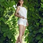 Beautiful sexy woman wearing dress walk park sun shine makeup — Stock Photo #74332915