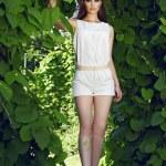 Beautiful sexy woman wearing dress walk park sun shine makeup — Stock Photo #74333001