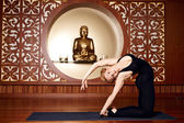 Woman blond youga pilates fitness budha India Asia — Stock Photo