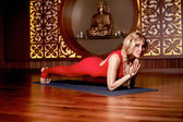 Woman blond youga pilates fitness budha India Asia — Stock Photo