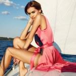 Beautiful sexy brunette girl in dress makeup summer trip yacht — Stock Photo #76625401