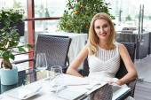 Beauty sexy business woman in restaurant in white fashion dress — Stock Photo