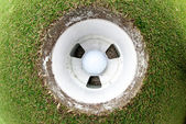 Golf Ball in the hole — Stock Photo