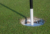 Golf Marker in Hole — Stock Photo