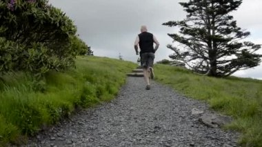 Trail Runner Passes By — Stock Video