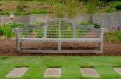Wooden Bench in Iris Garden — Stock Photo