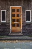 Wooden door and windoes in European town — Stockfoto