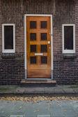 Wooden door and windoes in European town — Stock Photo