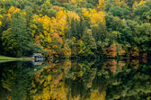 Boathouse Along Lake in Fall — Stock Photo