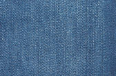 Texture of blue jeans textile close up — Stock Photo