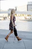 Blonde woman with crutches — Stock Photo
