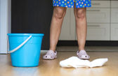 Cleaning lady in the kitchen — Stock Photo