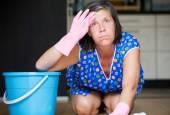 Woman scrubbing the floor — Stock Photo