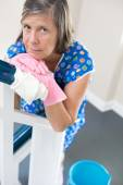 Woman cleaning banisters — Stock Photo
