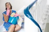 Cleaning lady sitting on stairs — Stock Photo