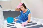 Woman cleaning the staircase — Stock Photo