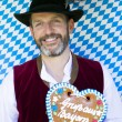 Bavarian man with gingerbread heart — Stock Photo #54277033