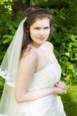 Young woman in a wedding dress — Stock Photo